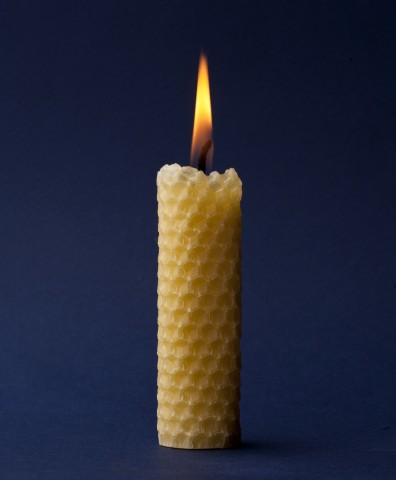Wax candle on a dark blue background