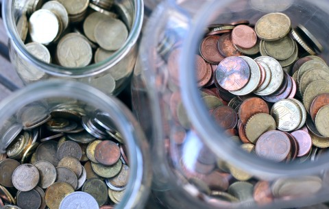 Different Coins In Glass Jars